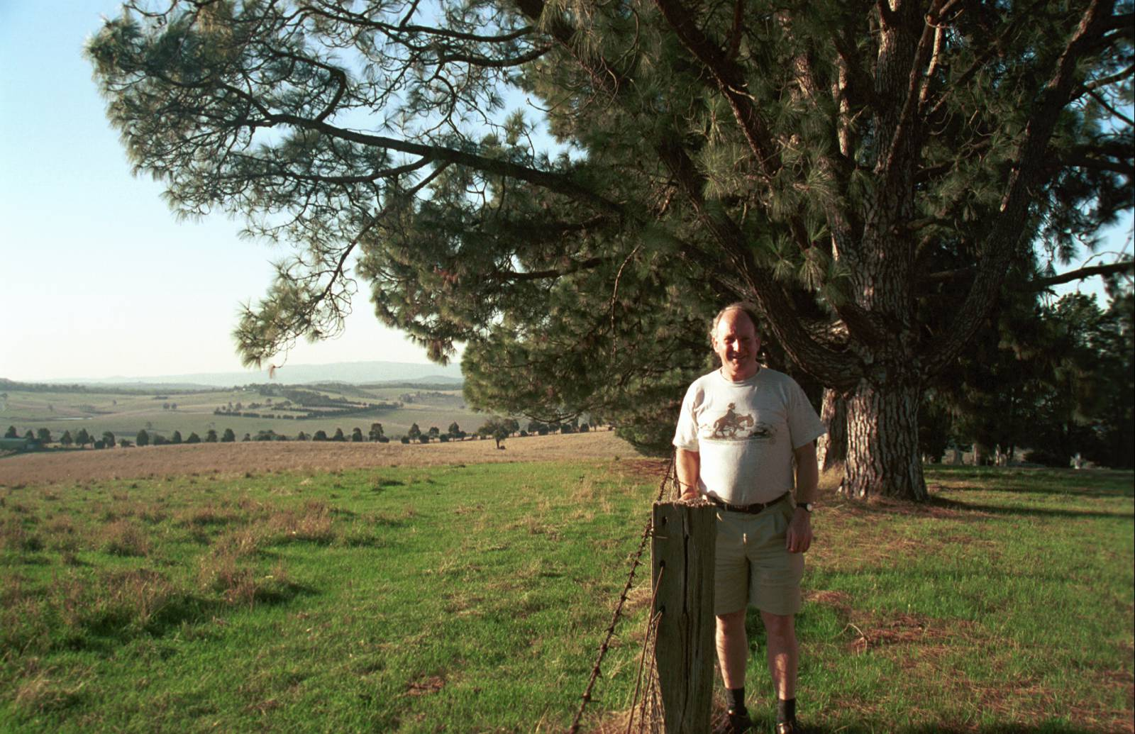 The author, Bruce G. Draper stands on the border of Arthurs Creek Cemetery overlooking the original Hazel Glen homestead, in 2001