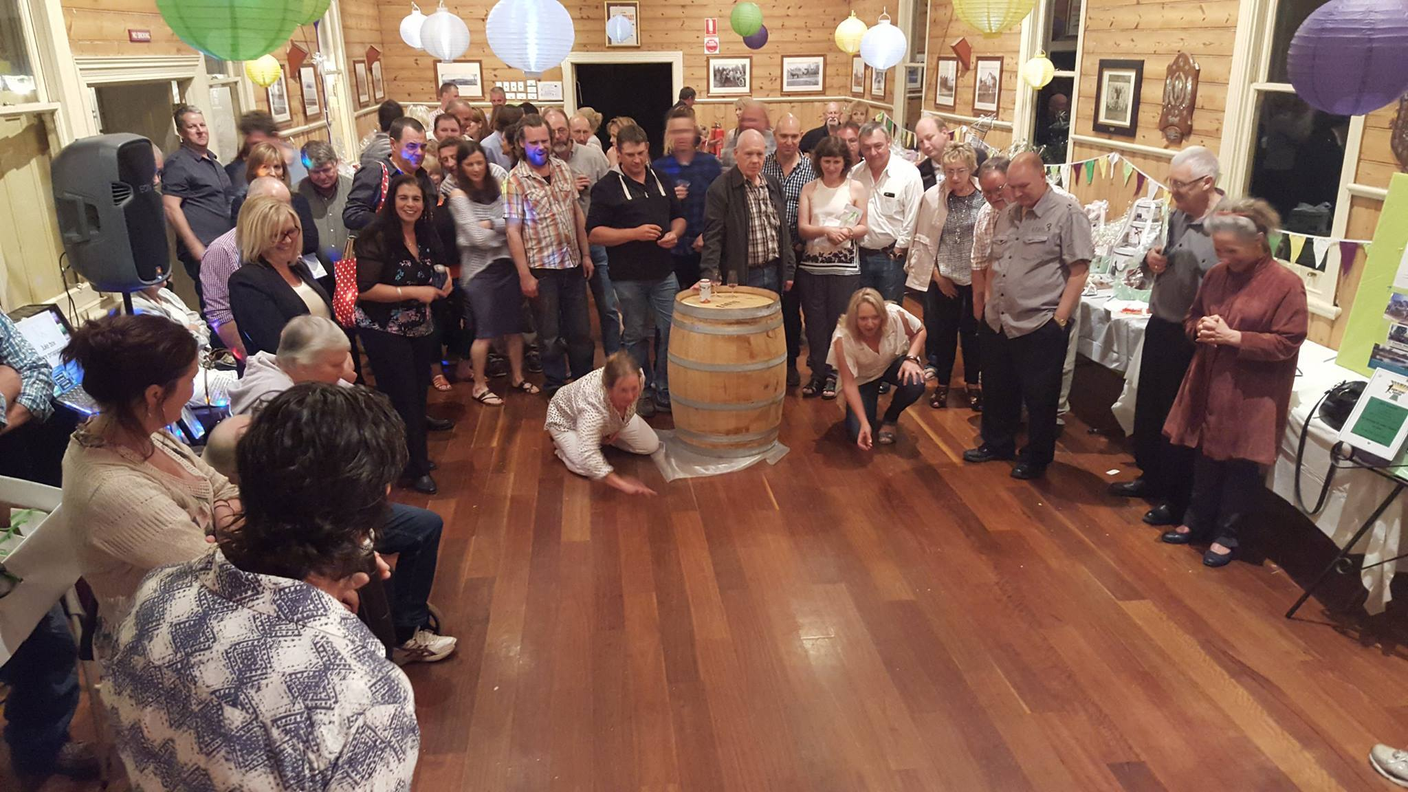 Arthurs Creek Primary School parents playing a modified form of Two-Up (a traditional Australian game) at Arthurs Creek Mechanics Institute Hall