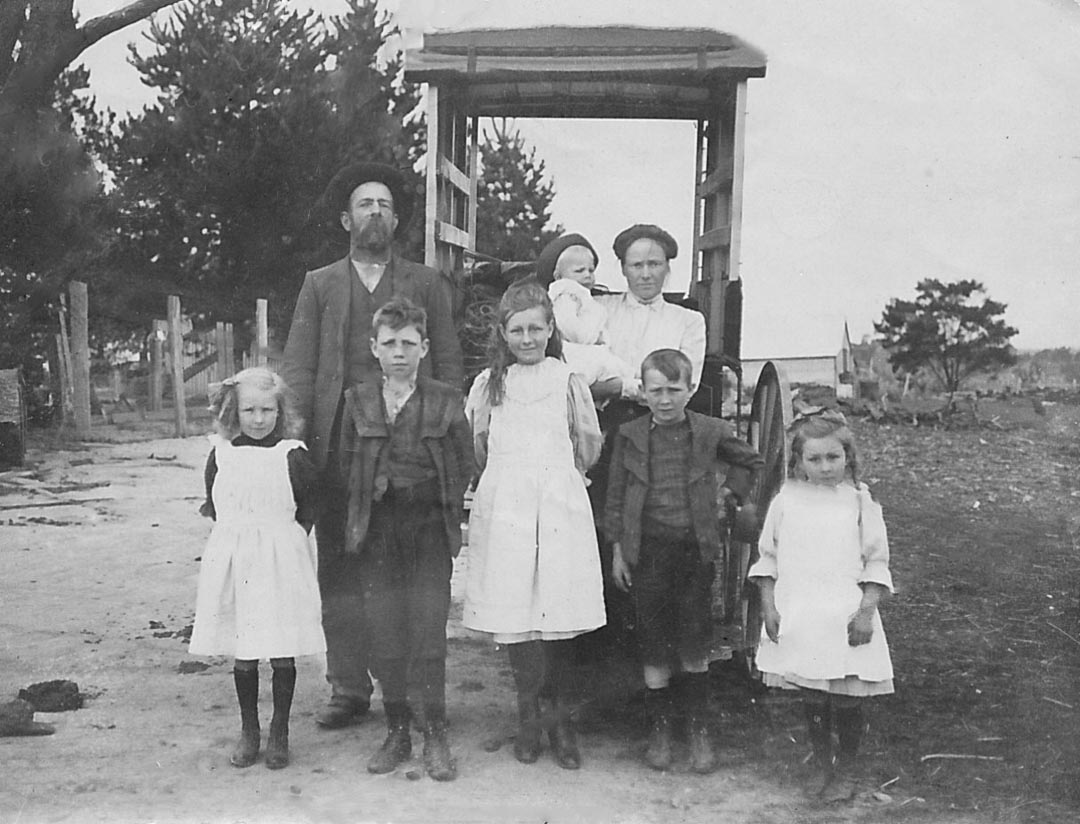 James Draper, 1863 - 1940 and Blanche Draper (nee Hurrey), 1880 - 1968; the author's grandparents.  Pictured with their children, from left to right Lily (1906 - 2003), Thomas (1903 - 1959), Catherine (1901 - 1997),  James Chester (the author's father, 1905 - 1998),  and Muriel (1907 - 2003).  Blanche is holding Leslie (1909 - 1992).  Pictured at their property, 'Barton Hill', Yan Yean and Arthurs Creek district, Victoria c 1910
