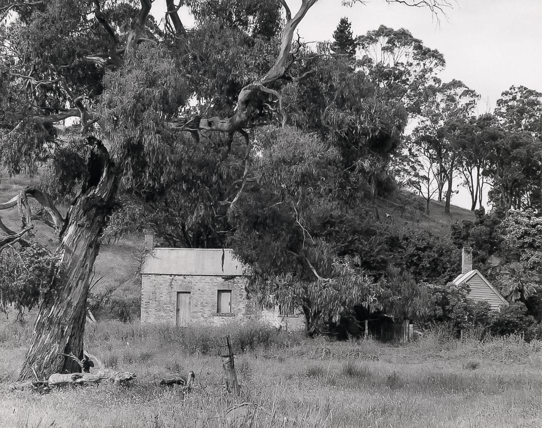 'Charnwood' photographed by Bruce G. Draper in 1968, showing the remains of the stables with the kitchen block behind.  Roy McDonald remembered that around 1920 'they lived in the large building – with a weatherboard cottage beside, attached by a walkway…down the side of the house there were windows which we used to peer through to see the rooms full of furniture.  We lived in this barn of a place with some stone floors, open fire place, big table…Mum used to say it was the servant's quarters but….it could have been the kitchen because they had big parties' credit Ross McDonald, 'From Laggan to Arthurs Creek'
