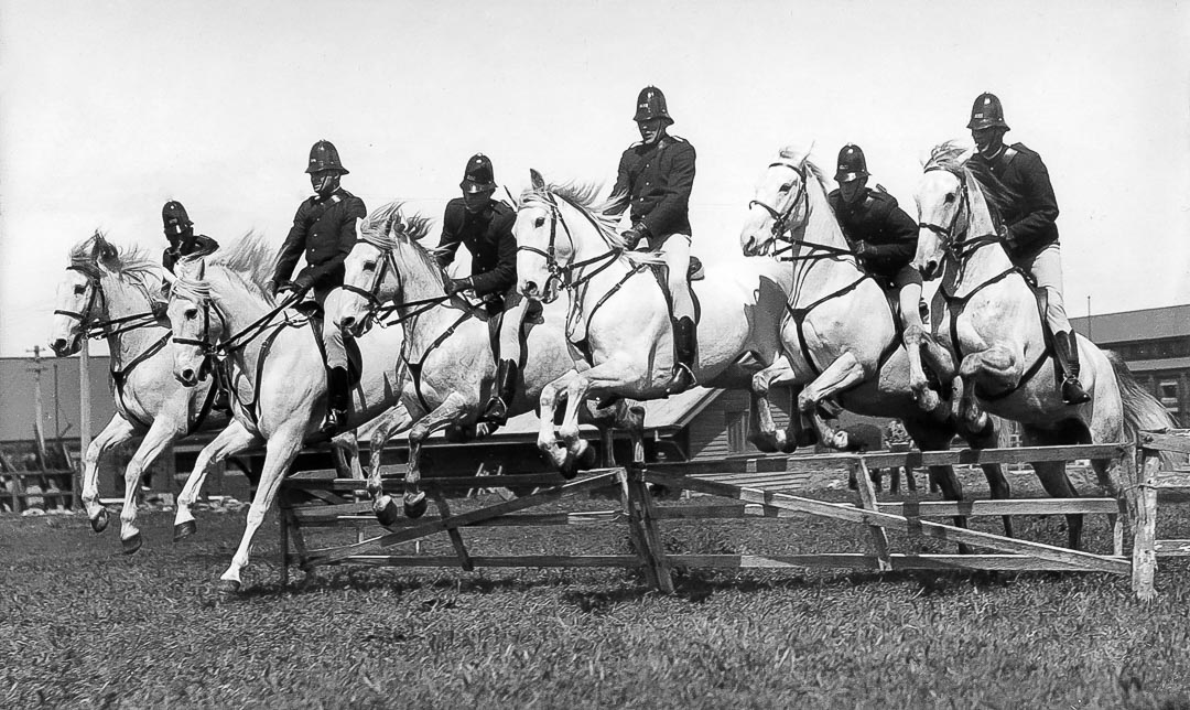 Horsemanship in the Victorian Mounted Police.  James Chester Draper is pictured 4th from left during training at the Victorian Police Mounted Branch Depot oval in St Kilda Road in 1929