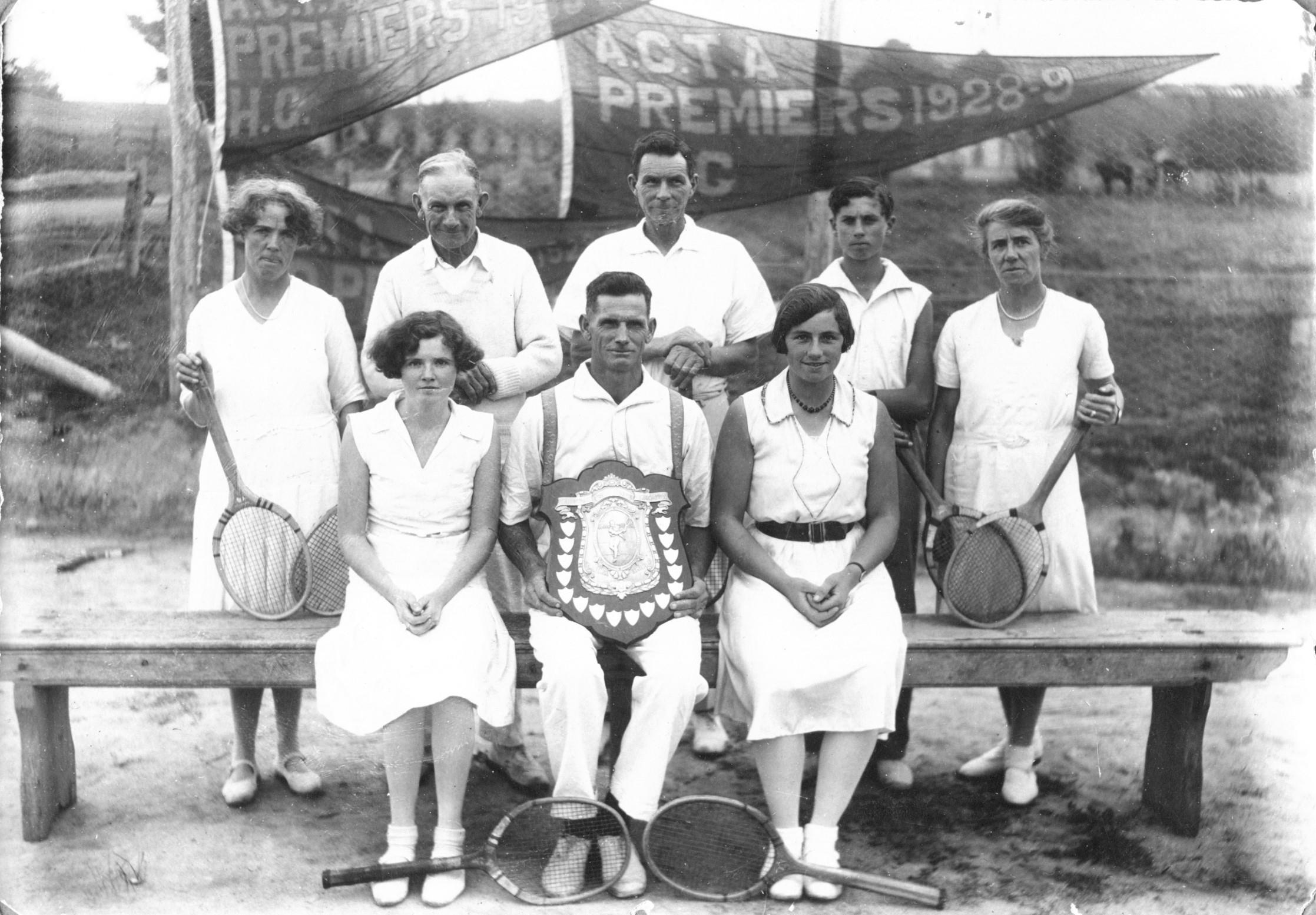 Arthurs Creek Tennis Association, Hazel Glen Club, Premiership Winners 1931-32.  Photo taken at the Hazel Glen tennis court located on the corner of Bannon's Lane North and Doctor's Gully Road (Hazelglen Hall is the background).  Back row left to right: Alice Victoria 'Vic' Laidlay, W. Stephens, Everard Bassett, Neil Laidlay (son of Vic & Bill), Lina Bassett (sister-in-law of Everard).  Back row: Isabel 'Bel' Laidlay, William 'Bill' Laidlay (husband of Vic), Jean Bassett (daughter of Everard).   The Hazelglen Hall became a centre for the Hazel Glen Church of England, the Hazel Glen Private Assembly, Arthurs Creek Cricket Club, Arthurs Creek Rifle Club, Hazel Glen Football Club and Hazel Glen Tennis Club.  Photo and information credit Neil Brock