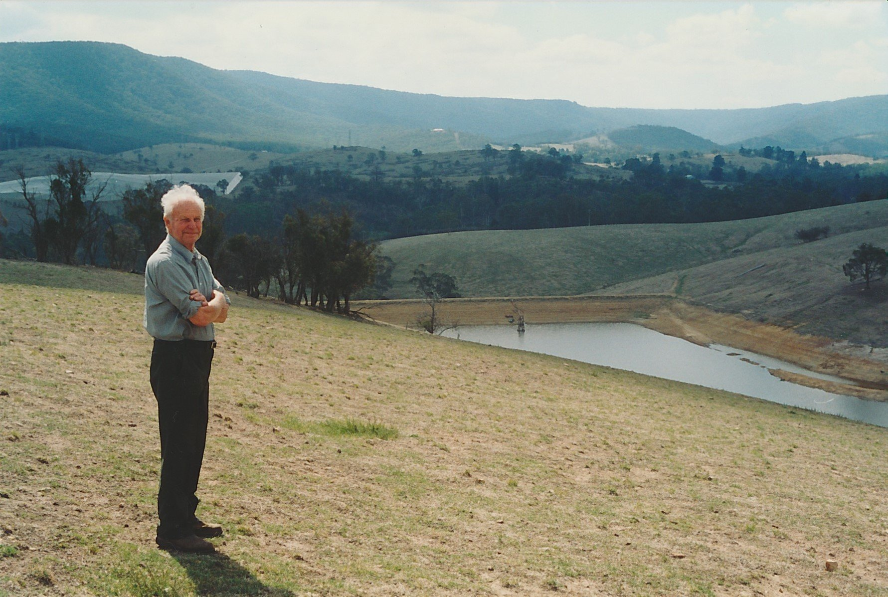 The author's friend, Lindsay George Apted (1922-2010) overlooking the Big Dam at 'Glen Ard' towards the headwaters of the Arthurs Creek and Mount Sugarloaf.  Bruce G. Draper, November 2003