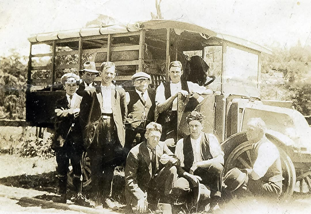 Orchardists ready to depart on a fishing trip in Apted's International fruit truck, 1920s.  Left to right back row: Bill Tiddins, Col Macmillan, Alec Healey, Pat Lodge, Les Apted.  Front row: Harry Christian, Les Schultz, George Apted