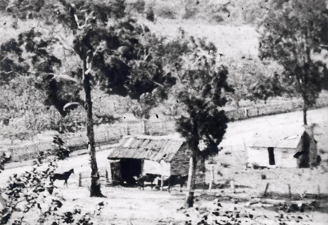 The Village Smithy or Blacksmiths shop and hut at the corner of Greens Road in the 1890s.  Once part of 'Ivy Bank' farm, the Ryder family gifted the site to the Catholic Church for the erection of the 'Church of the Irish Martyrs'.  This opened 4th November, 1928