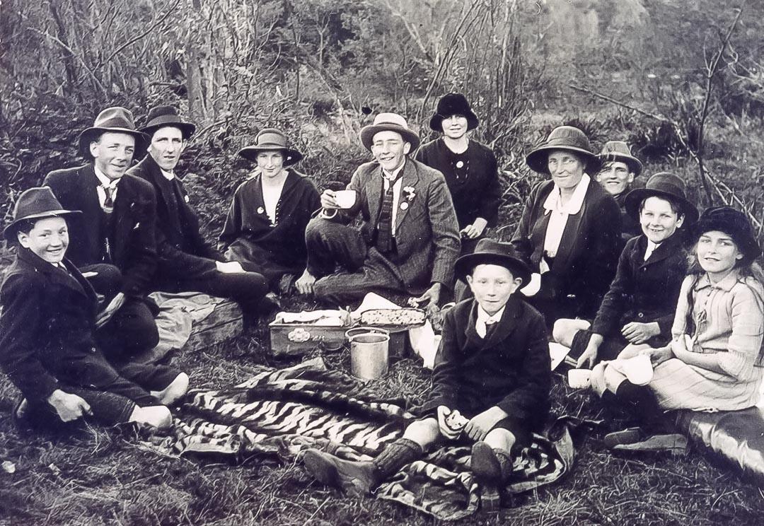 Draper family of 'Barton Hill' and friends at the annual picnic at Yan Yean Reservoir c 1920.  Left to right: Leslie Stafford 'Staff' Draper (1909 – 1992), Thomas 'Tom' Barton Draper (1903 – 1959), Dave Murphy, Lily Evelyn Draper (1906 – 2003), James Chester 'Ches' Draper (1905 – 1998), Muriel Blanche Draper (1907 – 2003), Mrs Blanch Draper (nee Hurrey, 1880 – 1968), Joe Murphy, George Edward Draper (1911 – 1993), Sylvia Iris Draper (1913 – 1996)
