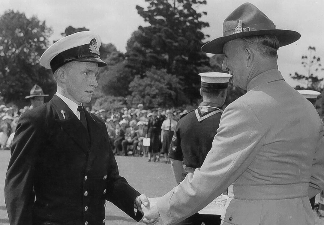 Accepting his Queen's Scout Award from Sir Dallas Brooks, Governor of Victoria, at Government House in Melbourne November 22, 1957.