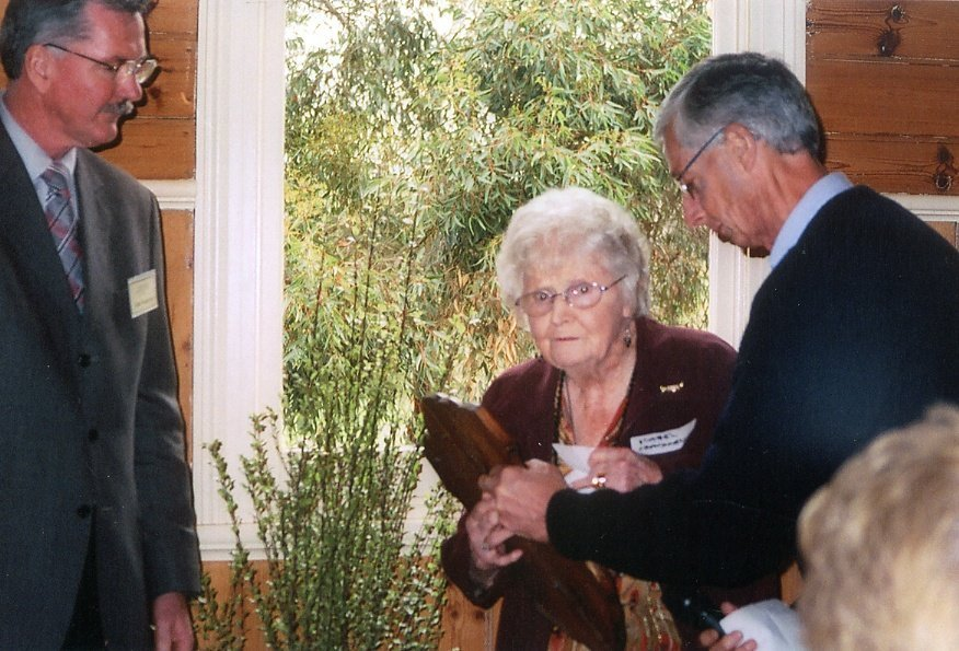 Isabel 'Bel' Cracknell (nee Laidlay), the only living member of the Hazel Glen Tennis Club Premiership Winners 1931-32, presenting the Arthurs Creek Tennis Association Challenge Shield to the Hall Committee. The Brock family donated this historic shield to the Arthurs Creek Mechanics Institute at the History Day and Plaque Unveiling Ceremony on the 11th September, 2005.  Photo and information credit Neil Brock