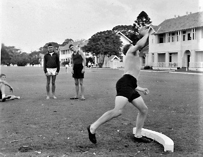 Bruce was described as a fine sportsman especially in discus, javelin and shotput.  Pictured in 1959 competing in the shotput, in a photo Bruce's friend John Ingram took and developed for the RANC Magazine