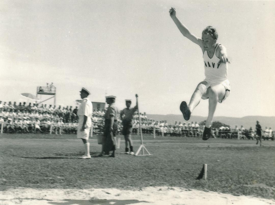 Broad Jump Event, Winning Jump, Distance 20ft 6.5 inches.  Inter-Service Colleges' Carnival Athletics at HMAS ALBATROSS, N.S.W. 1959.   While at Jervis Bay Bruce gained colours for Athletics