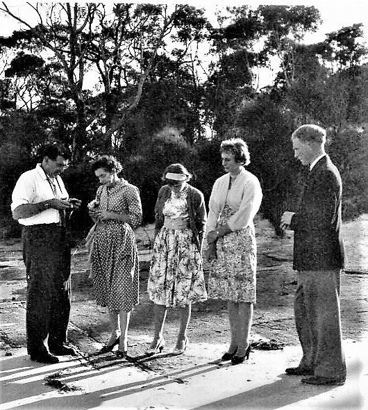 """""""With my parents on the beach at Huskisson in 1959.  Note our two lady friends were in heels!! (They'd attended the Sunday morning parade at College, so were dressed for the occasion)"""". Photo and information credit John Ingram"""