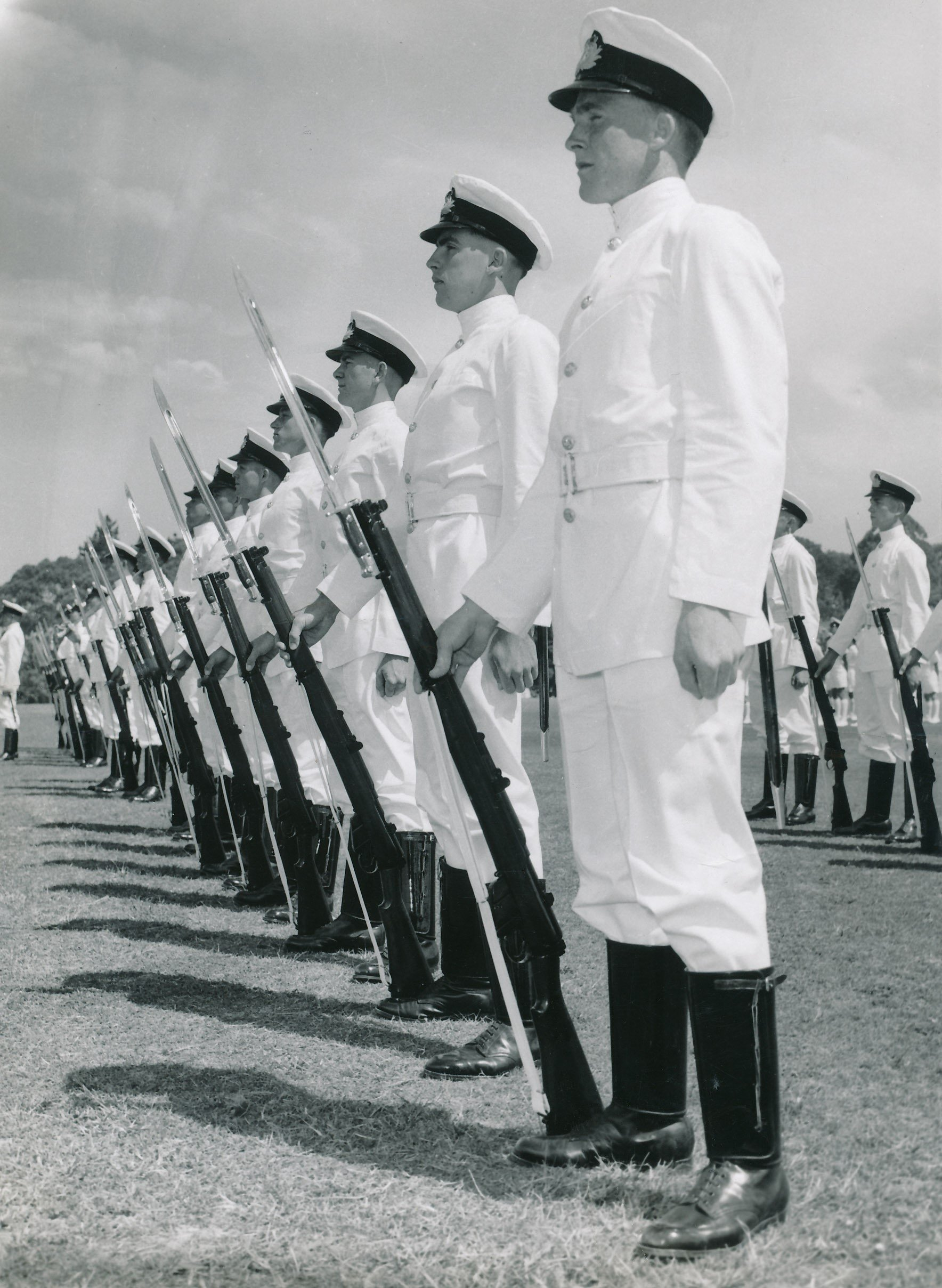"""Bruce's 1959 graduation, he was left hand marker in the Guard for the ceremony, at the Royal Australian Naval College.  """"He was Cadet Captain in our graduation parade in December 1959.  That's me next to Bruce"""" (John is second from right in photo, Bruce furthest right).  Photo and information credit John Ingram"""