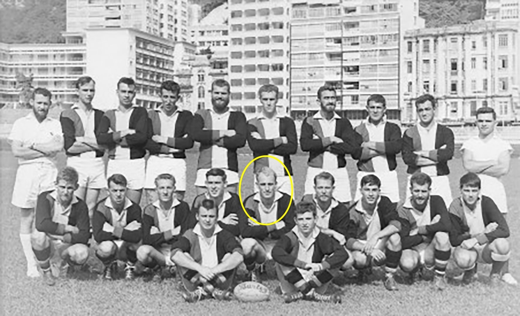 Australian Rules Football Navy team HMAS DUCHESS (vs. HMAS SYDNEY) in Hong Kong during a mid-deployment break.  DUCHESS had a crew of around 330 and could field its own Aussie Rules team.  Back row, far left: Deputy Marine Engineer officer of DUCHESS at the time (1965-66), Lieutenant Bob Nattey RAN.  Seated next to Bruce on his right: Lieutenant Adrian Waite RAN.  Bruce is the team Captain.  Information credit John Ingram, Chris Bolton, Ian Pfennigwerth